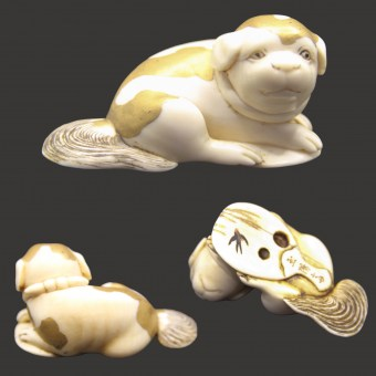 Netsuke - Young Dog sitting on a Fan